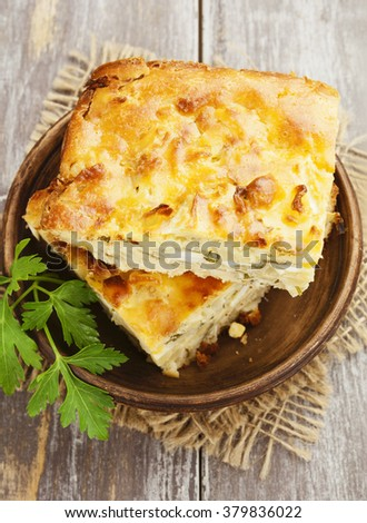 Pie with cabbage and eggs on the table