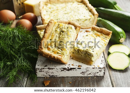 Pie with zucchini and herbs on the table
