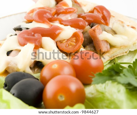 Piece of a pizza with vegetables on a plate on a white background (close up)