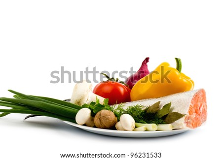 Piece of a salmon with vegetable on a white background - stock photo