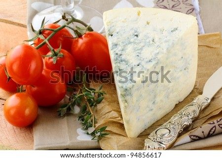 piece of blue cheese, tomato  and cheese knife - stock photo