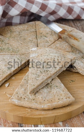 piece of bread from rye flour with dill closeup
