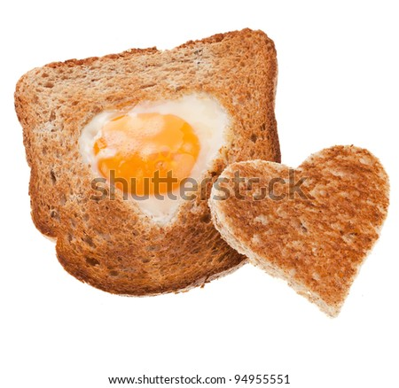 piece of bread toast cut in shape of heart with egg Isolated on white background - stock photo