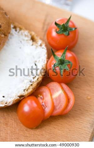 piece of brown bread with cottage cheese and tomatoes - stock photo