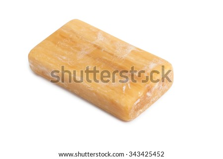 Piece of brown soap isolated on white background - stock photo