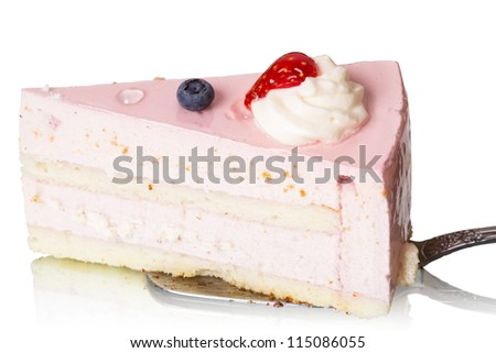 Piece of cake souffl���© with whipped cream isolated on white background.