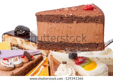 Piece of cake with coffee and fruit souffle - stock photo