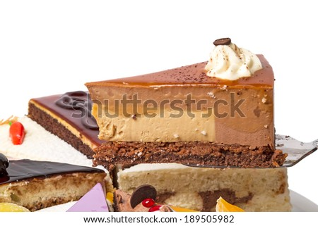 Piece of cake with coffee beans and  souffle - stock photo