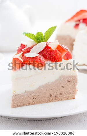 piece of cake with whipped cream and strawberries, close-up, vertical - stock photo