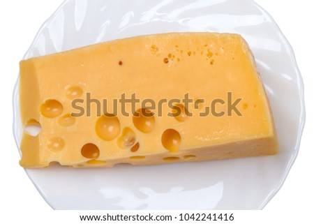 Piece of cheese on a white and white background