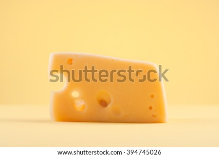 piece of cheese with holes on isolated background