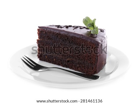Piece of chocolate cake with mint isolated on white - stock photo