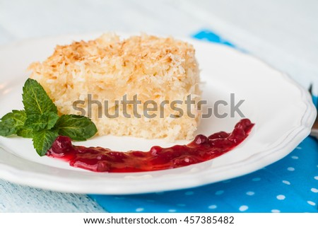 piece of coconut cake with berry jam.