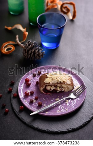 Piece of delicious cake, cranberry dessert, chocolate roll, served with lemonade. - stock photo