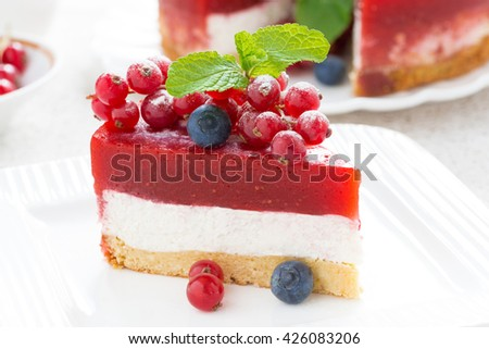 piece of delicious cheesecake with berry jelly on a plate, close-up - stock photo
