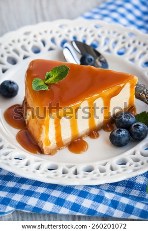 Piece of delicious cheesecake with caramel sauce - stock photo