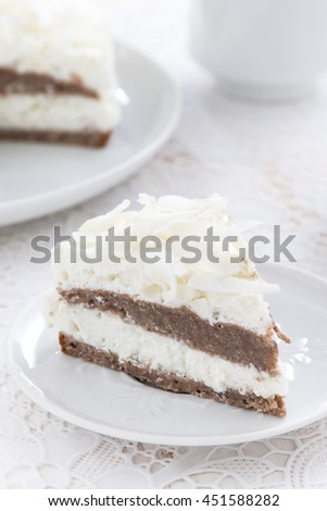 piece of delicious chocolate cake with coconut cream, vertical, close-up - stock photo