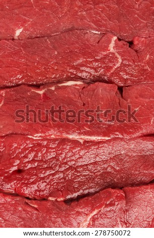 Piece of fresh raw meat background, close-up - stock photo