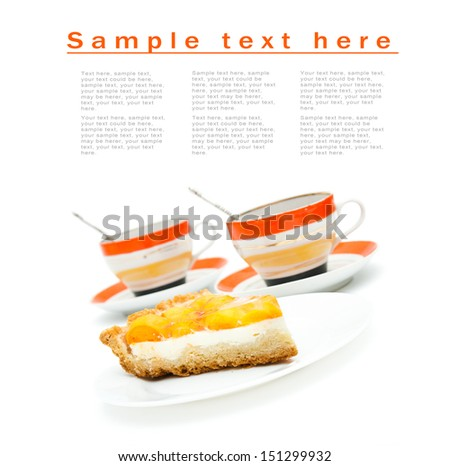 piece of fruit cake and two cups isolated on white - stock photo