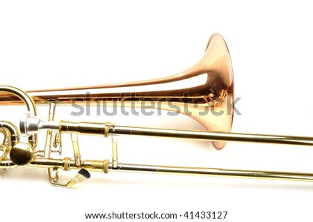 Piece of gold trombone on white background - stock photo