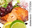 piece of grilled salmon, lettuce and lemon,grapes - stock photo
