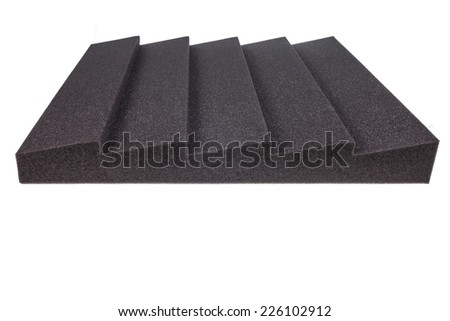 piece of microfiber insulation for noise in music studio or acoustic halls , rooms or houses , professional studio insulation material , noise isolation , noise isolating protective absorber foam - stock photo