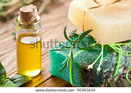 Piece of natural soap with oil and herbs. - stock photo