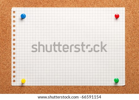 Piece of paper on a cork board close up - stock photo