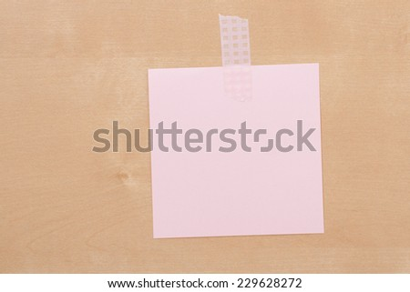 Piece of Paper On Wooden Notice Board With Space For Text. - stock photo