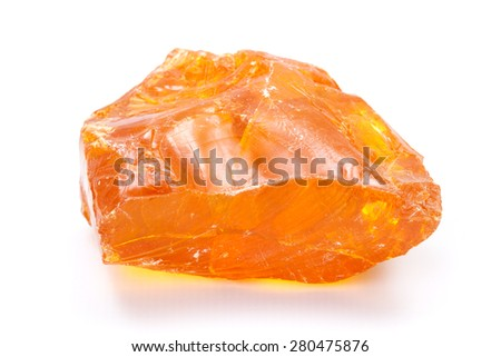 Piece of purified, solid fir rosin (colophony or Greek pitch) used for soldering aid - stock photo