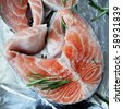 Piece of raw fresh salmon with spices and green oregano - stock photo