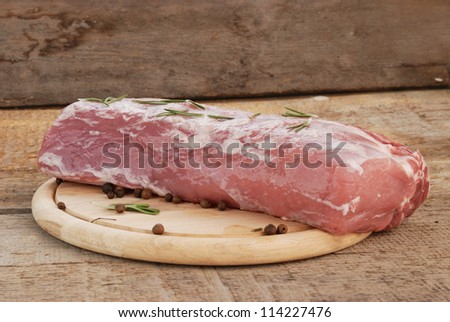 piece of raw meat on wood board