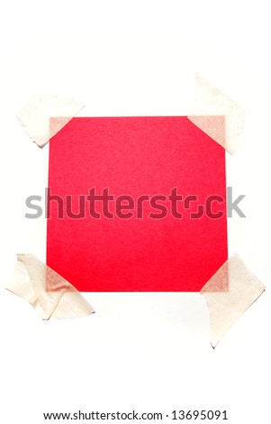 Piece of red paper taped to white