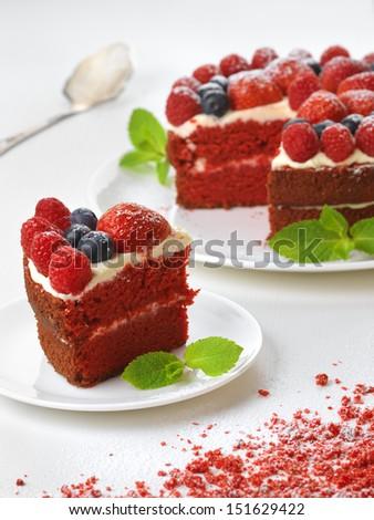 Piece of red velvet cake on plate, studio shot - stock photo