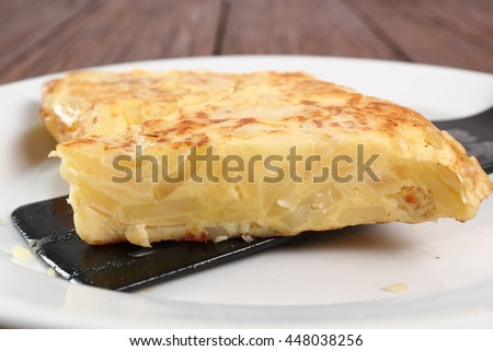 Piece of Spanish omelette on plate. Macro.