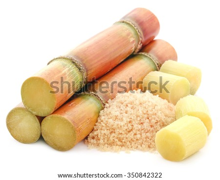 Piece of sugarcane with red sugar over white background - stock photo