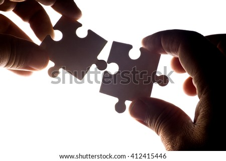 Piece of the Jigsaw with light from behind - stock photo