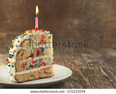 Piece of Vanilla Sprinkles Cake - stock photo