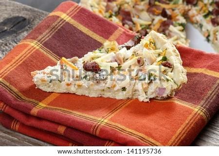 Piece of vegetable tart. Selective focus - stock photo