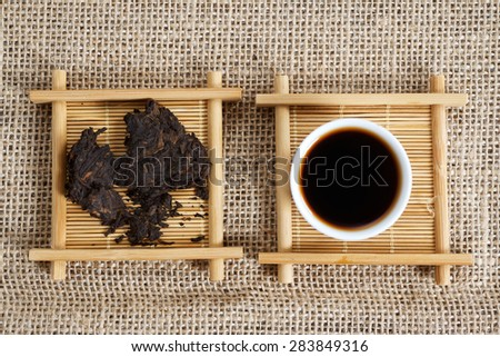 Pieces Chinese Puer tea and cup. Yunnan province China - stock photo
