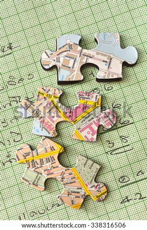 Pieces of a map puzzle on paper with hand written - stock photo