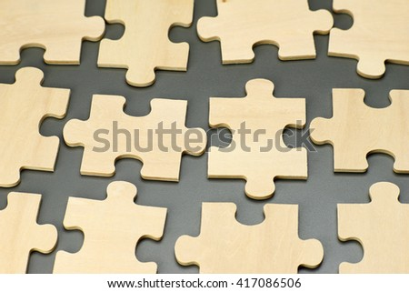 pieces of a wooden puzzles - stock photo