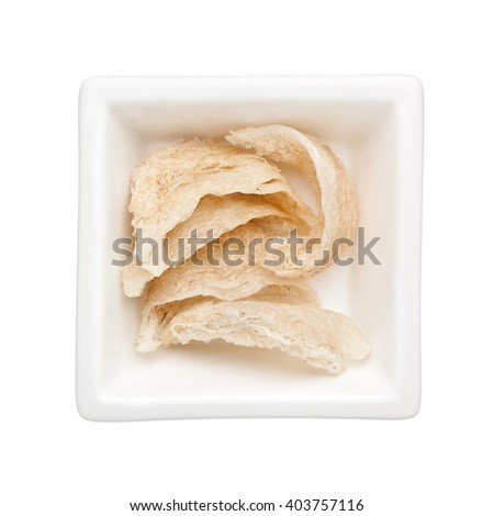 Pieces of bird's nest in a square bowl isolated on white background