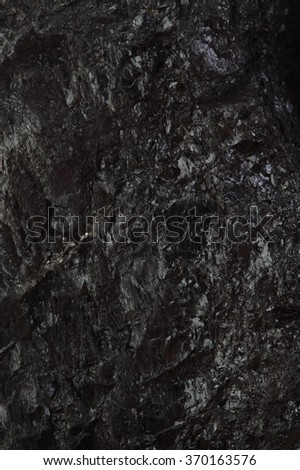 Pieces of black fossil coal texture background - stock photo