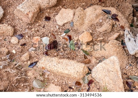Pieces of broken glass on the ground in a ghost town - stock photo