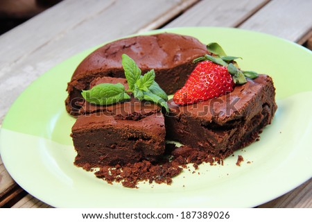 Pieces of brownie decorated with strawberry - stock photo