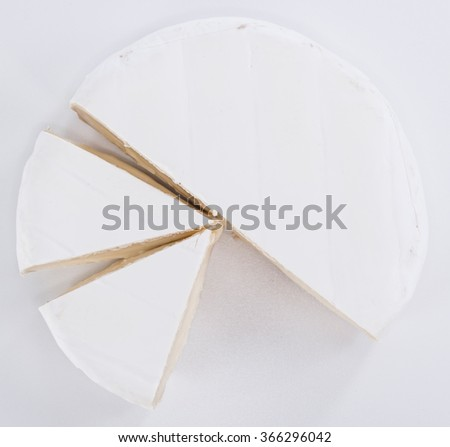 Pieces of Camembert on grey background (close-up shot)