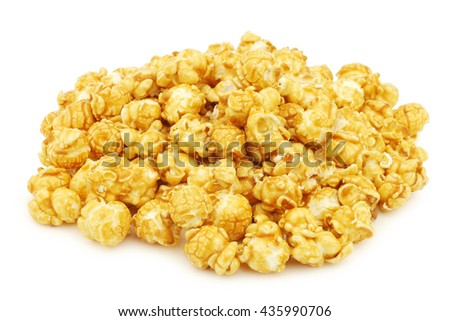 pieces of caramel popcorn on a white background - stock photo