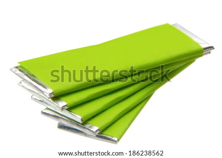 pieces of chewing gum with green packaging isolated on the white background - stock photo