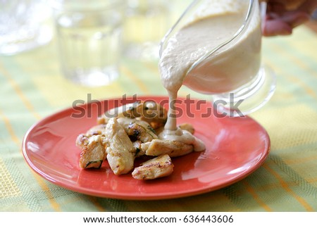 Pieces of chicken breast with sauce